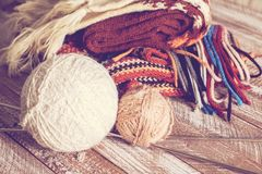 Knitting needles and yarn on rustic wooden background Royalty Free Stock Images
