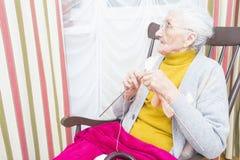 Knitting old lady Stock Image