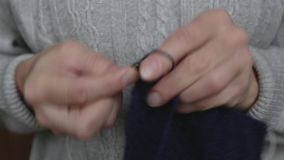 Knitting old woman. Close up hands of elderly woman. Macro soft focus. stock video