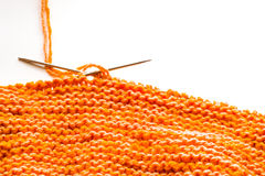 Knitting, orange wool on white Stock Image