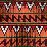 Knitting ornate seamless ethnic pattern with geometric color  Royalty Free Stock Images