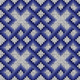 Knitting ornate seamless pattern in blue and white colors. Abstract knitting ornamental seamless vector pattern as a knitted fabric texture in blue and white Royalty Free Stock Photos