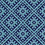Knitting ornate seamless pattern in dark and light blue hues. Abstract knitting ornamental seamless vector pattern as a knitted fabric texture in dark and light Stock Image