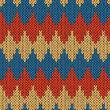 Knitting ornate seamless pattern with geometric color figures Royalty Free Stock Photo