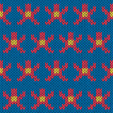 Knitting ornate seamless pattern with geometric figures  Royalty Free Stock Photography