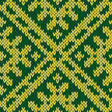 Knitting ornate seamless pattern in green and yellow colors Stock Photography