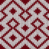 Knitting ornate seamless pattern in muted dark red and white col Stock Image