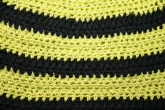 Knitting pattern. Pattern crochet, cotton and wool, black and yellow stripes Royalty Free Stock Photos