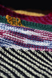 Knitting Pattern. Close-up of knitted squares, waiting to be stitched into a blanket Stock Image