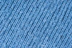 Knitting pattern blue wool. Close up of diagonal knitting pattern blue Royalty Free Stock Photography