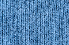 Knitting pattern blue wool. Close up of knitting pattern blue Stock Images