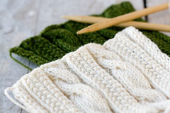 Knitting pattern and needles on a background Stock Photography