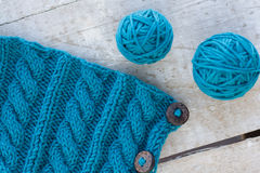 Knitting pattern and needles on a background Stock Photos