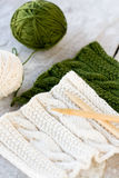 Knitting pattern and needles on a wooden background Stock Images
