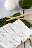 Knitting pattern and needles on a wooden background Stock Image