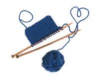 Knitting pattern on wooden needles Stock Photo