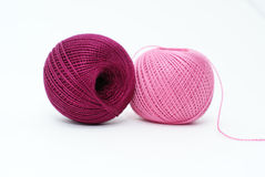 Knitting with pink and purple yarn. Two cotton yarn balls of pink and purple colors isolated on white background stock image