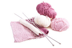 Knitting with pink and white wool Royalty Free Stock Image