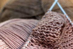 Knitting of pink wool. Thick pink knitting wool on metal spokes Royalty Free Stock Photography