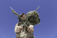 Knitting power. The young woman holding a knitting equipment. Point of view form below Stock Images