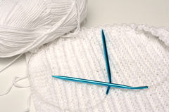 Knitting project and needles Royalty Free Stock Photos