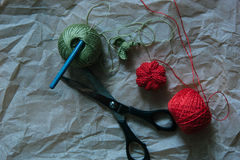 Knitting pumkin with scissors, ball of yarn and crochet hook Royalty Free Stock Images