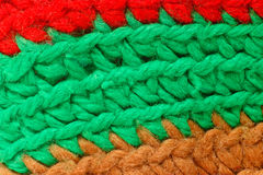 Knitting red green brown macro texture background stock photo