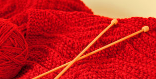 Knitting a Red Scarf Stock Image
