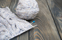 Knitting on rustic wooden background Royalty Free Stock Images