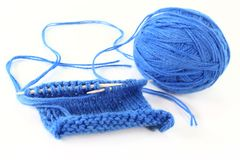 Knitting sample. A blue ball of wool with a knitting sample stock images