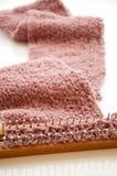 Knitting scarf stock photos