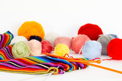 Knitting scarf with colorful wool threads Stock Images