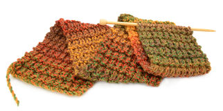 Knitting a scarf in fall colors Stock Images