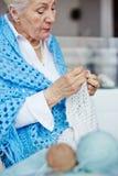 Knitting scarf Royalty Free Stock Photo