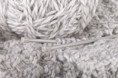 Knitting a scarf. Knitting of a handmade scarf royalty free stock photography