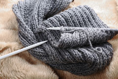 Knitting scarf with needles, close up Royalty Free Stock Images