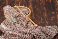 Knitting of Scarf or Snood. Yarn Balls. Wooden Stock Photo