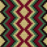 Knitting seamless geometric pattern in muted colors Royalty Free Stock Photography
