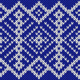Knitting seamless ornate pattern in blue and white colors. Abstract knitting ornamental seamless vector pattern in blue and white colors as a knitted fabric Royalty Free Stock Images