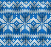 Knitting seamless pattern background with snowflakes vector Stock Images