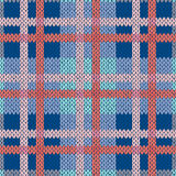Knitting seamless pattern in blue and pink hues. Knitting seamless vector pattern with perpendicular lines as a woollen Celtic tartan plaid or a knitted fabric Stock Photo