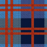Knitting seamless pattern in blue and red hues Stock Photo