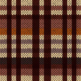 Knitting seamless pattern in brown, beige and coffee hues. Knitting seamless vector pattern with perpendicular lines as a woollen Celtic tartan plaid or a Stock Photo