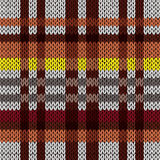 Knitting seamless pattern in brown, red, yellow, and grey hues Royalty Free Stock Photos