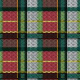 Knitting seamless pattern. Knitting seamless vector pattern with perpendicular lines as woollen Celtic tartan plaid or knitted fabric texture in red, pink, green Royalty Free Stock Photo