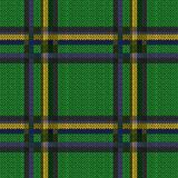 Knitting seamless linear pattern. Perpendicular lines grey, blue, yellow and khaki hues on the bright green background as woollen Celtic tartan plaid, knitting Royalty Free Stock Photos