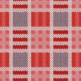 Knitting seamless pattern in red, pink and grey colors Royalty Free Stock Photos