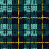 Knitting seamless pattern in turquoise, dark blue and yellow. Knitting seamless vector pattern with perpendicular lines as a woollen Celtic tartan plaid or a Stock Image