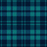 Knitting seamless pattern in various blue hues. Knitting seamless vector pattern with perpendicular lines as a woollen Celtic tartan plaid or a knitted fabric Royalty Free Stock Image
