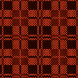 Knitting seamless pattern in various red and brown hues Royalty Free Stock Photography